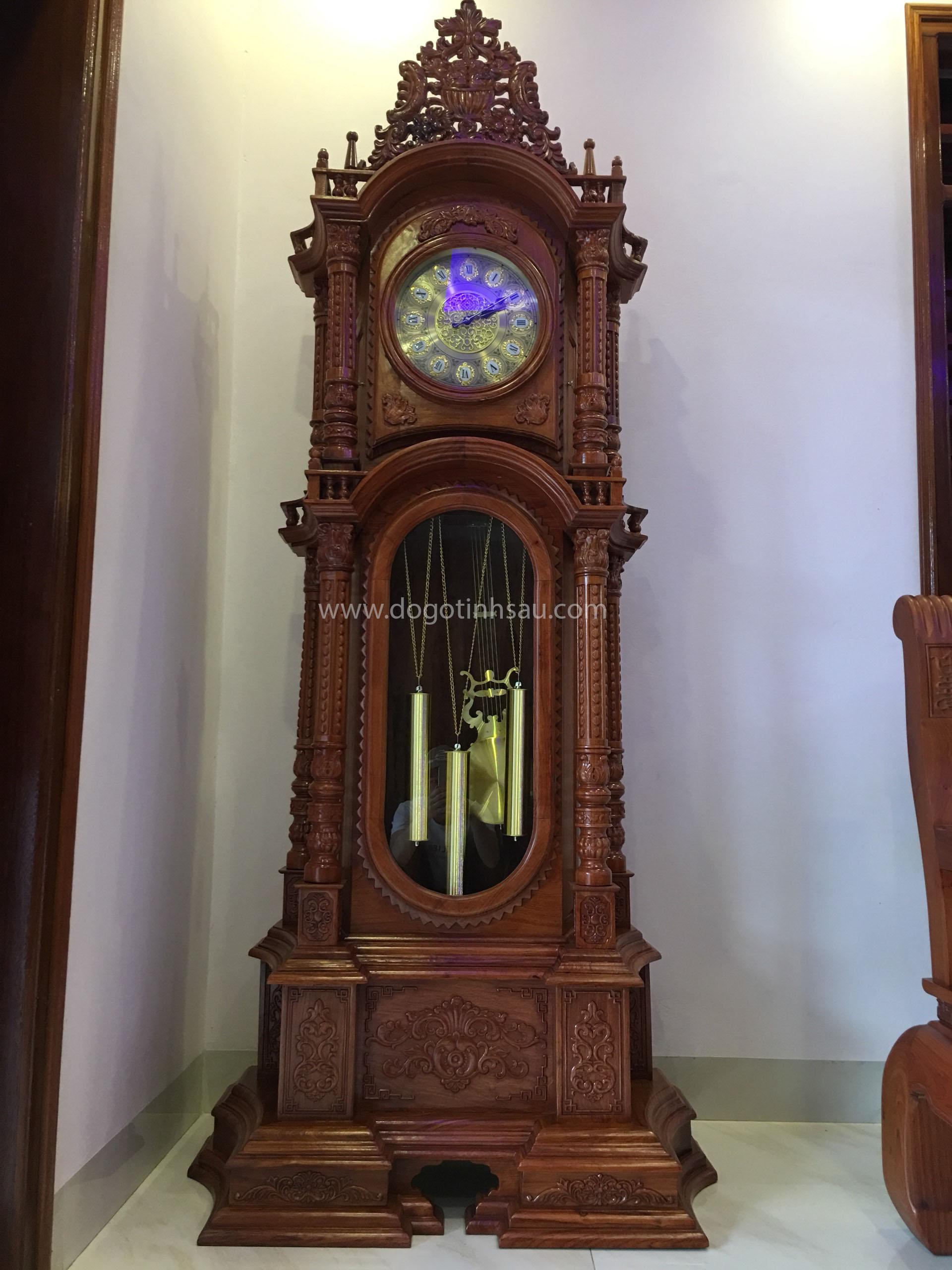 dong ho cay go huong da - Đồng hồ cây gỗ hương đá kiểu dáng tháp tứ trụ vát